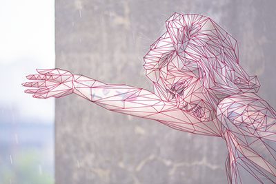 Depiction of a young girl with her arm extended in a faux low poly style created by drawing the polygonal lines. The stock image used is faded underneath to showcase the reference used.